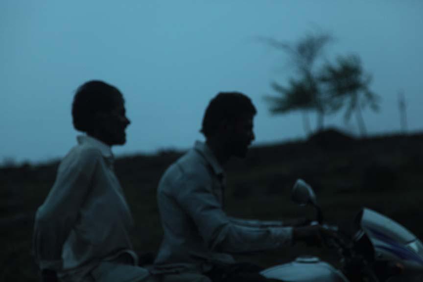 Riders in the rain, India