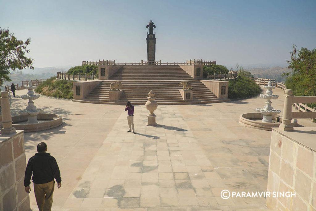 The 'Pragya Shikhar', commemorative granite pillar.