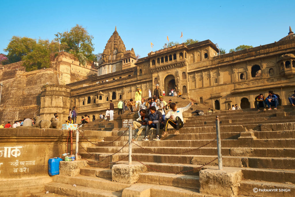 Youth taking selfies on Maheshwar Ghats